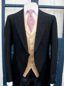 Modern M&S morning coat with Hackett single breasted notched lapel waistcoat and red and white linen tie