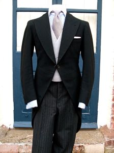 Black morning coat, double breasted grey waistcoat and black houndstooth tie