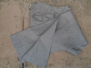 A vintage pair of high waisted houndstooth trousers - so rare they should be called hen's teeth trousers!