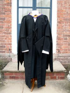 Manchester MA gown (Ede & Ravenscroft), Manchester MA hood (C.H. Wolfenbloode), Mortar Board (J. Whipple)
