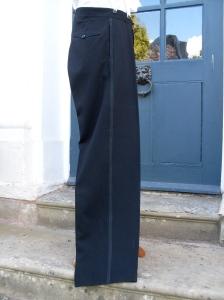 Very high waisted trousers! Nice.